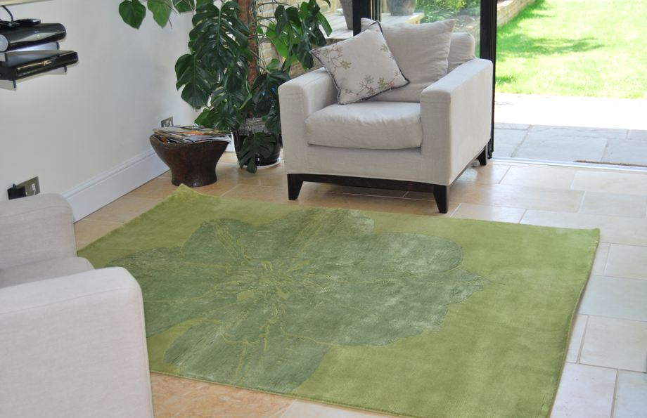 green rug with flower staged