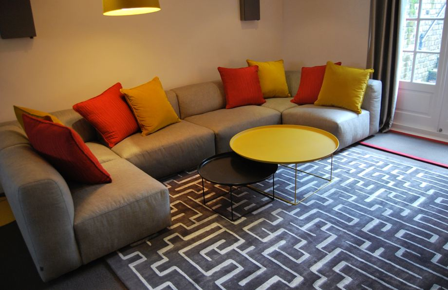 bespoke art rug staged in a beautiful living room