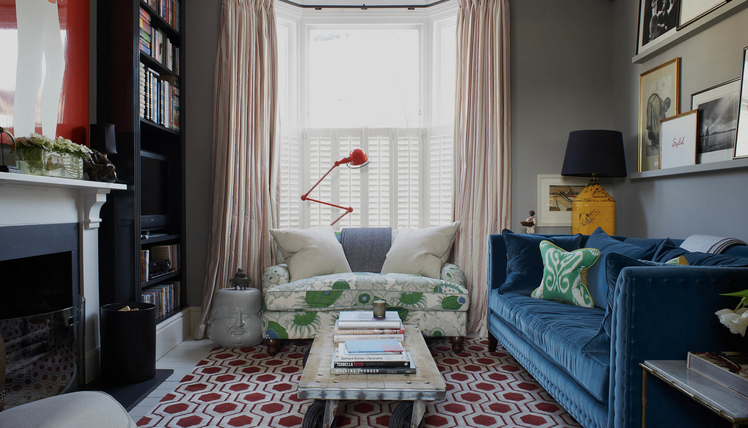 bespoke red rug staged in a small living room